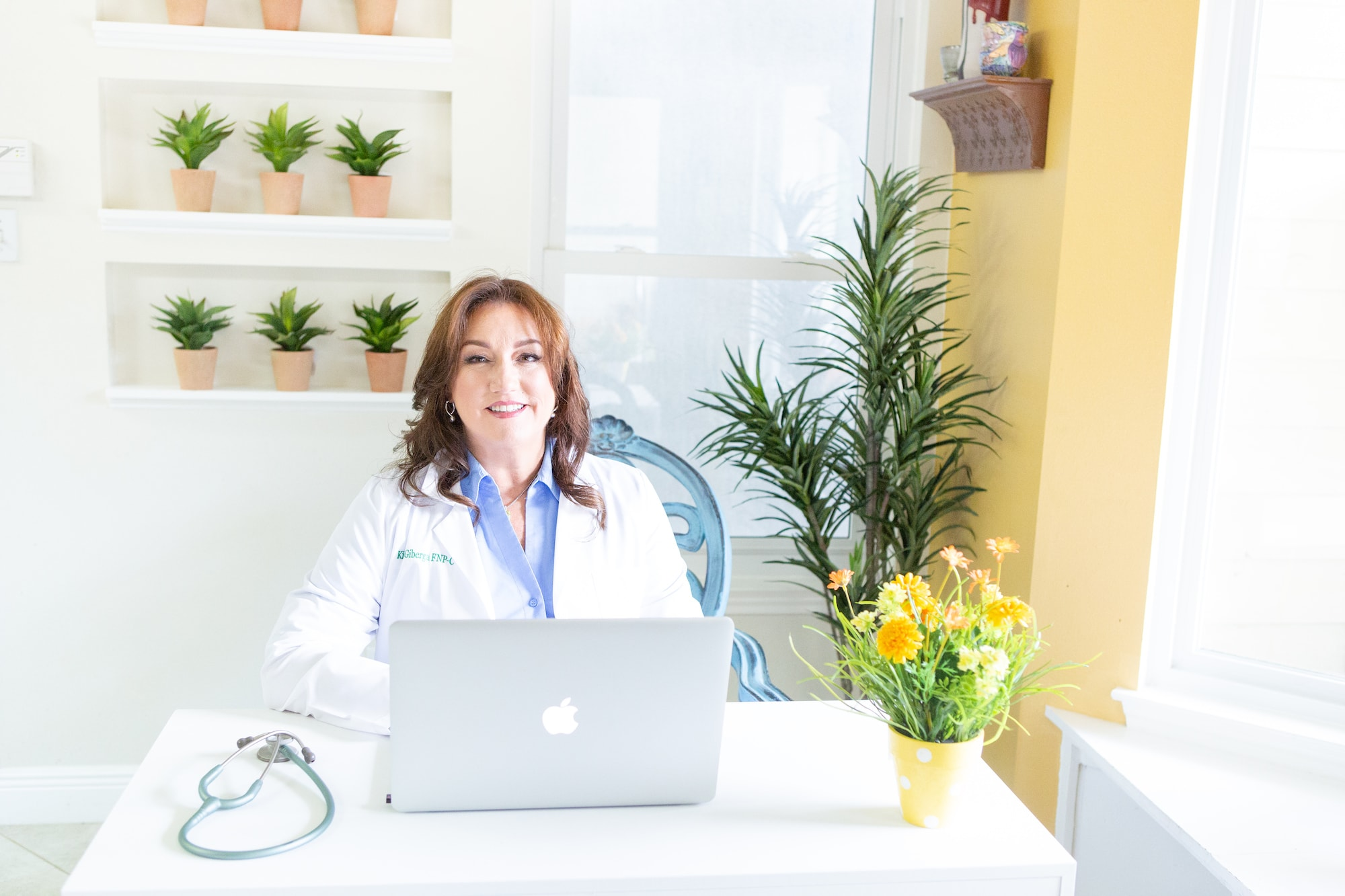Doctor sitting at desk by Paty Araujo Photography